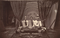 A Print from a Negative (found in the Palace) of King Theebaw, Queen Soopy-a-lat and her sister